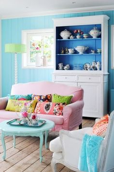 Colorful living room - love the shelving/storage