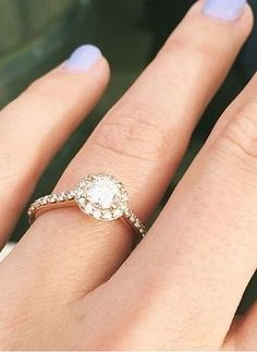 This sparkling halo diamond ring is beautiful.