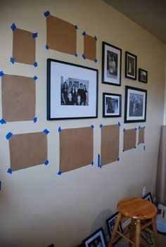 If you're trying to decide on an arrangement for your shelves and picture frames, trace an outline of the frames on butcher paper or construction paper and tape them to the walls.