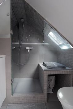 Beautiful gray tiled shower in a small attic                                                                                                                                                                                 More