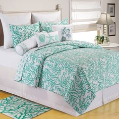 Invoke a nautical ambiance with this coastal designed quilt. Overlapping coral reefs on aqua complete the look. This quilt is crafted of 100-percent cotton and conveniently machine washable. Set inclu