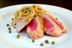 Seared ahi tuna with whole wheat pasta in a garlic lemon caper sauce - Yum! Ahi Tuna Recipe, Tuna Recipes, Lemon Recipes, Sauce Recipes, Seafood Recipes, Cooking Recipes, Cooking Time, Cooking Ideas, Vegetarian Recipes