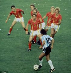 By Steven Powell (1982)-  In his first World Cup, in Spain in 1982, Diego Maradona gave six Belgians the run around. The foundations were laid in his five games in the tournament and four years later the Argentina legend steered his country to the greatest prize in football.  I like it interesting because it is about Maradona. I like the way the way the photograph is take,with attention focused on Maradona.
