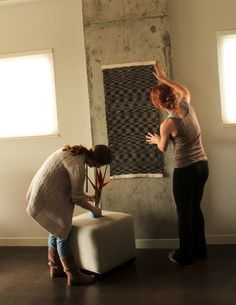 A behind the scenes look at a re:loom website vignette photo shoot... re:loom rug being hung by stylist Alex Mia Hernandez; also featuring re:loom marketing director Shannon Yarbrough :) Photograph shot by me (Polly Nance)