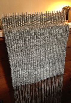 Peg loom weaving in progress, using our own Navajo-Churro wool.