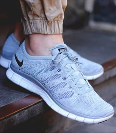 huge selection of e2174 d39db Wolf Grey NIKE Free Flyknit tennis shoes, a sporty accessory for an  everyday look.