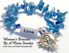 """Speedy delivery,Excellent customer service and quality materials.Bracelet For Women Taino Inspired """" Magu'ey"""" ( Sun in Taino) """" Live And Feel """" Reversible. is made from rare Rare Coral , Blue Swarovski Crystal and Metal. Flip the word and it goes from Live to Feel. """"Live And Feel"""" woman's bracelet reminds me to live my life fully and feel grateful for all of the goodness in my life.   by ANenaJewelry, $39.99"""