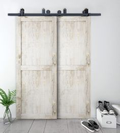 Add the farmhouse style to your home with these sliding barn door ideas! There are so many barn door styles and barn door designs to choose from so use our guide to help you decide the right barn door decor for you. Barn Door Decor, Hanging Barn Doors, Diy Barn Door, Barn Door Closet, Barn Door Track, Farm Door, Double Sliding Barn Doors, Sliding Barn Door Hardware, Interior Door Knobs