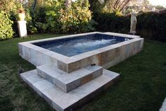 Picture of a Swim Spa installed above ground with marble slab cabinet and steps.