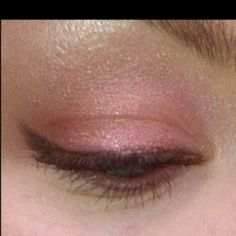 Pale pink neutral eye with winged brown liner. :)