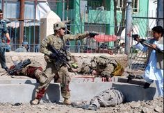 An American Soldier surrounded by his fallen brothers.