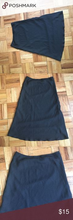 Black and white polka dot skirt. Below the knee skirt. Flowey at the bottom. Great for work. Skirts
