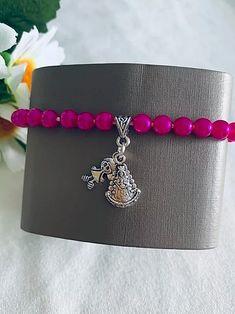 Pulsera infantil recuerdo de la Virgen del Rocío. Hecho a mano. Materiales: acero. 2,99€ Bracelets, Silver, Jewelry, Hot Pink, Steel, Souvenirs, Hand Made, Bangle Bracelets, Jewlery