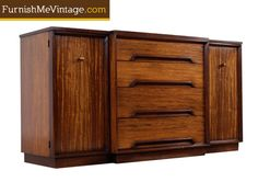 """Outstanding mid century modern credenza by Milo Baughman for Drexel. The rare piece is from Drexel's """"Perspective"""" collection, vintage 1950s. Made in America with exotic Mindoro wood from the Phillipines."""