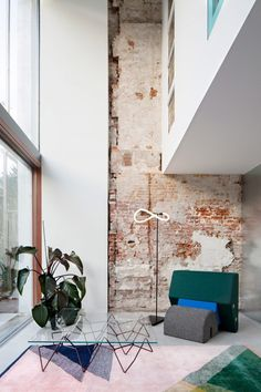 Shift exchanges brickwork for glazing to create bright apartments in Rotterdam townhouse