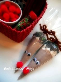 Cocoa cones dressed up like Rudolph. - Put enough cocoa in a disposable pastry bag for 2 cups of cocoa. - Top with some mini marshmallows, mini chocolate chips, and some sprinkles. - Close with a brown chenille stem and tie into a bow. - Glue on googly eyes and a red pom pom nose.   - Tie a tag with directions and who they are from as well.