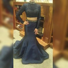 NOT AVAILABLE UNTIL 4/10/16 Sherri Hill Prom Dress AVAILABLE APRIL 10TH. I'm listing this dress now since I know it might take time to gain interest. This is a navy two piece Sherri Hill dress. It is absolutely stunning and very sparkly. Only alteration done is the skirt underneath was hemmed since I kept tripping. I'm 5'2 and wearing 5 in high heels in the picture. If you have any questions feel free to ask! If interested let me know, I will mark dress as unavailable until the 10th, and…