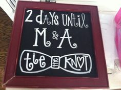 Chalkboard sign with a countdown to a wedding!