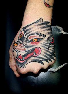 wolf head tattoo on hand myke chambers by Myke Chambers Tattoos,