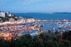 The wonderfully picturesque Torquay at dusk all a glow Holiday Places, Holiday Destinations, Holidays In England, Devon Holidays, Torquay Devon, Lost City Of Z, South Devon, Devon England