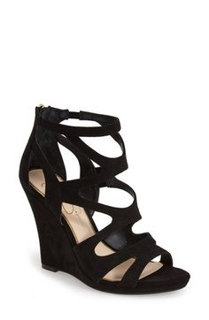 Free shipping and returns on Jessica Simpson 'Delina' Sandal (Women) at Nordstrom.com. This supersoft sandal features a mix of curvaceous straps at the vamp and is balanced by a wrapped wedge heel. A round toe and gleaming hardware add to the allure, while hidden goring and a plush footbed ensure a comfortable ride.
