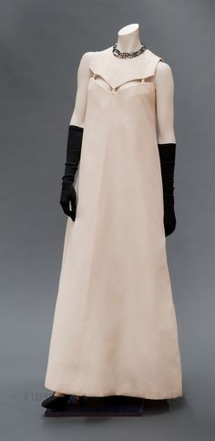 1966 Dior, white dress with cutaway detail at the neckline.