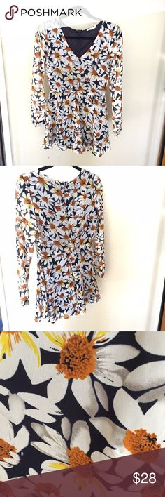 Lush daisy bohemian romper Lush long sleeved shorts romper. Navy blue with white and yellow daisy print. Chiffon material with navy lining. Super cute and flowy. Size small, fits true to size. In excellent condition with no visible wear. Lush Pants Jumpsuits & Rompers