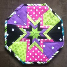 Folded Star Hot Pad.  Pattern by Plum Easy Patterns.