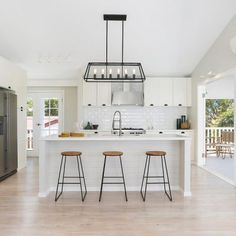 Hamptons inspired kitchen design for modern and monochrome interior lovers Hamptons Kitchen, The Hamptons, Monochrome Interior, Interior Design, Long Sofa, New Living Room, Coastal Homes, Design Consultant, Kitchen Design