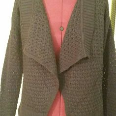 Ann Taylor Knitted Navy  Blue  Cardigan The picture dosent do this justice. Navy blue open cardigan. The third picture shows the Third picture shows true color. knitted pattern. The color doesn't show well, however,  the color is dark navy blue. Ann Taylor Sweaters Cardigans
