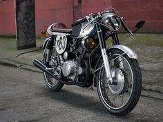 Honda CB160 custom. The guy who built this, did so by taking spare parts from junk piles. Great job!