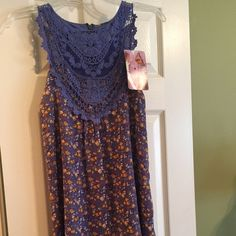 Dress Never worn with tag, very small but shows medium. Beautiful lace front Dresses