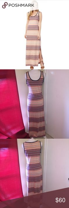 Tommy Hilfiger Striped Maxi Dress NWT Welcome the season of breezy carefree days in this beautiful flowing maxi dress featuring a trend-right unique feeder stripe layout from Tommy Hilfiger. Gorgeous western, boho, desert colors. Has a slight slit along left side. 100% Cotton. Tags damaged to prevent returns. Tommy Hilfiger Dresses Maxi