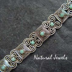 I like the way this is constructed.  I can imagine this with brighter beads.  Maybe one of the links for matching earrings.