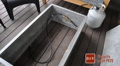 Learn how to make an outdoor gas fireplace. Detailed Video tutorial, photos, and plans.This is a high end looking fireplace made out of concrete! Outdoor Fire Table, Outdoor Gas Fireplace, Deck Table, Diy Gas Fire Pit, Fire Pits, O Gas, Backyard Pergola, Outdoor Stuff, Door Ideas