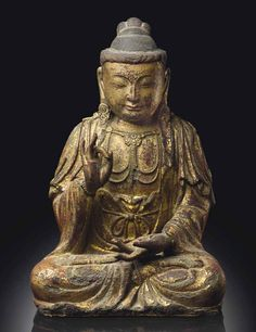 A DRY GILT-LACQUER SEATED FIGU