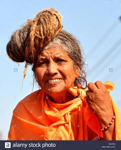Female Sadhu (Hindu Holywoman) arrive to take Shahi Snan (royal bath) at the bank of Sangam confluence of river Ganga. Stock Photo