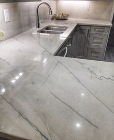 Kitchen renos: calacatta quartzite, excellent choice, doesn't stain, scratch, it's a natural stone and, without being marble, it still has a luxurious feel to it.