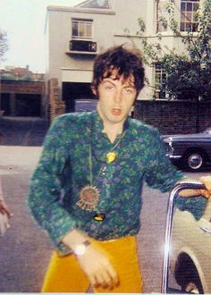 """London, 1967. """"It was the summer of bangles, beads, bells and badges and Paul had his fair share. The badge he can be seen wearing in the above shot featuring an image of an Indian squaw was the logo of the International Times, the underground newspaper, which was founded and edited by Paul's long time friend Barry Miles who later became his biographer"""""""