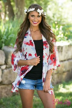 You'll feel as light and beautiful as a butterfly in this breezy white kimono! Featuring red, blue, and black floral print on a semi-sheer white fabric, it's superb all summer long! It also has small slit cutouts on each side at the very bottom and a slightly rounded hemline in front for trendy touches.