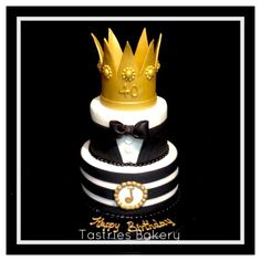 Gold, black and white tux birthday cake topped with a gorgeous gold crown made of fondant. @tastriesbakery