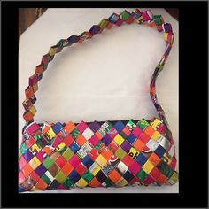 "NWOT ""Candy wrapper purse"". NWOT ""Candy wrapper purse"". Bottom measures approximately 10 1/2 inches long. Very sturdy straps. A fun mini handbag for all ages!! Bags Mini Bags"