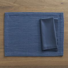 Grasscloth Smoky Blue Placemat with Cotton Smoky Blue Napkin in New Dining & Entertaining | Crate and Barrel