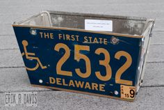 Planter made from old license plates.  But do you want to risk getting any state?
