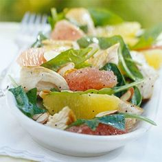 Pink grapefruit, turkey and a light honey-poppy seed dressing transform this spinach salad recipe into a low calorie main dish. Spinach, cooked turkey, 2   pink grapefruit, 2  oranges, 1/4  cup orange juice, 2  tablespoons olive oil, 1  teaspoon honey, 1/2  teaspoon poppy seeds, 1/4  teaspoon salt, 1/4  teaspoon dry mustard, 2  tablespoons sliced almonds