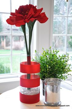 Love the idea of adding ribbon bands or scrapbook paper bands around vases for centerpieces.  These type of centerpieces would be great to add dimension and fill space in a big room.