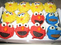 The Big Bird cupcakes were made by dying coconut yellow. The eyes were made from mini marshmallows with black icing eyeballs and piping blue and pink icing on top of eyelids. The beak was candy corn. Elmo was made by using red sprinkles for fur, white chocolate melting wafers for eyes with black icing piping & half an Oreo for mouth. For Cookie Monster, I used blue sprinkles for fur, the same ingredients for eyes as for Elmo & a Chips Ahoy cookie pushed into a slit I cut for a mouth.