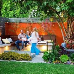 """After: Space savored  To help entice the family outdoors, Los Angeles landscape designer Steve Siegrist halved the lawn—leaving enough for the kids to play on—and ditched the family's old hot tub. Then, inspired by the couple's love of the tropics and the beach (they're surfers), Siegrist built an open-air lounge and dining patio, separated by a cooling lily pond. Now, says Darren, """"we spend as much time outside as we do inside."""" Design: stevesiegristdesign.com"""