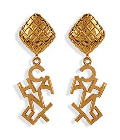 Detailed in polished gold-plated metal, these clip earrings from Chanel Vintage Jewelry feature a statement logo-lettered drop #Stylebop (BB)