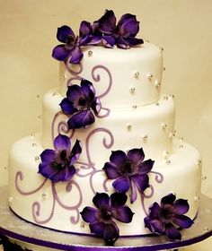 Wedding cake with purple flowers and bling!